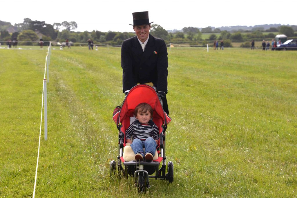 Sam Watson (pictured here with son Archie) is the overnight leader in the Haygain CIC3* ahead of the Cross Country phase on Sunday.